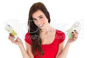 Cheerful brunette holding her cash money