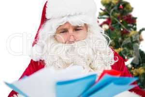 Father christmas showing many letters