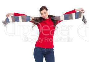 Cheerful brunette holding scarf and spread her arms
