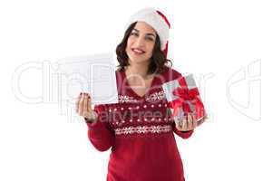 Brunette holding gift and sale sign