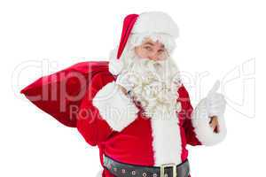 Santa claus with his sack and thumbs up
