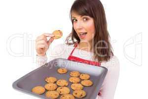 Festive brunette showing hot cookies