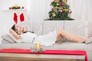 Brunette sleeping on the couch at christmas