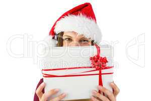 Festive brunette holding christmas present with bow