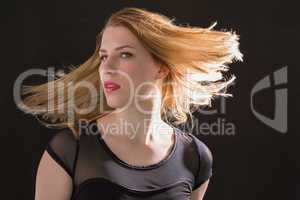 Pretty blonde woman tossing hair