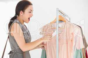 Pretty brunette shocked at price of shirt