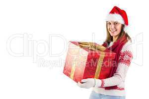 Girl standing while holding a present