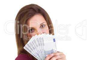 Festive brunette showing fan of euros