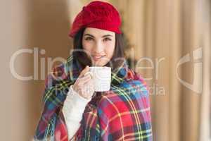 Brunette with cover holding mug