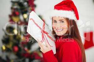 Festive redhead holding christmas gift