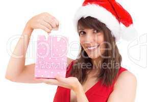 Festive brunette holding a gift bag
