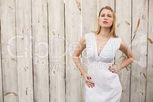 Elegant blonde standing hands on hips