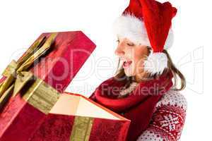 Amazed girl opening a magical christmas gift