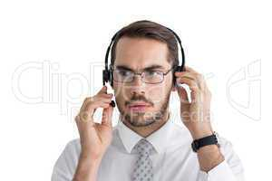 Portrait of a focused businessman with headphone