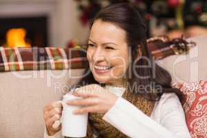 Brunette drinking hot chocolate with marshmallow