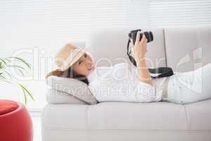 Photo editor looking at her camera