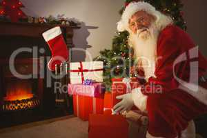 Smiling santa delivering gifts at christmas eve