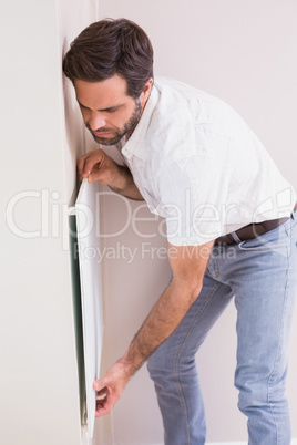 Handyman hanging up a radiator
