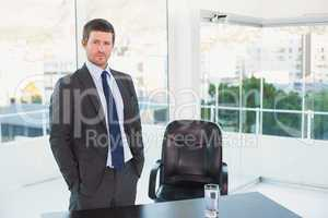 Posing businessman at his desk