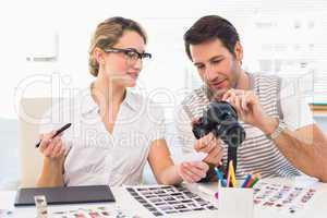 Photo editors looking at camera