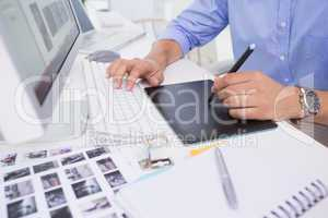 Graphic designer using digitizer at his desk