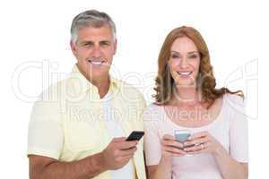 Casual couple sending text messages