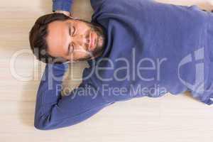 Sleeping man lying on floor