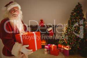 Happy santa delivering presents at christmas eve