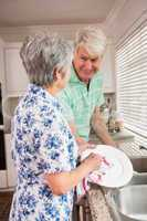 Senior couple washing the dishes