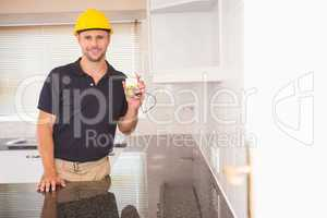 Construction worker showing a multimeter with cables