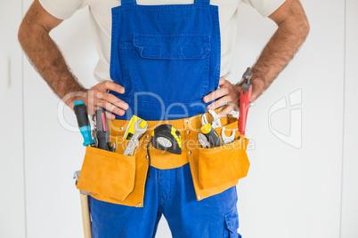 Handyman standing in tool belt