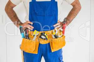 Handyman standing in tool belt