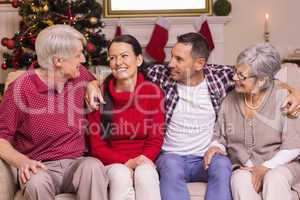 Portrait of a happy family sitting and speaking on sofa