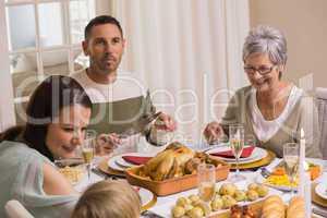 Smiling multi generation during christmas dinner