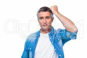 Doubtful man with his fist on head