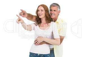 Casual couple smiling and pointing