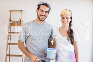 Cute couple redecorating living room