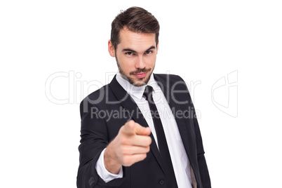 Smart businessman in suit pointing at camera