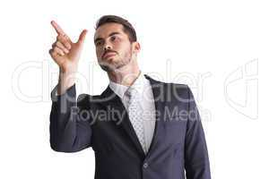 Concentrated businessman measuring something with his fingers
