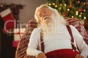 Santa claus sleeping on the armchair