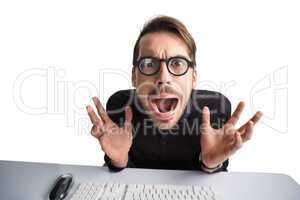 Worried businessman with glasses using computer