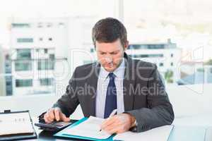 Businessman working on his finances at his desk