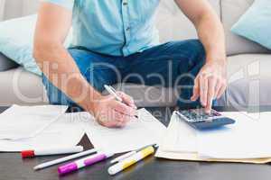 A man counting his bills at home