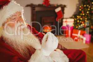 Santa claus holding engagement ring