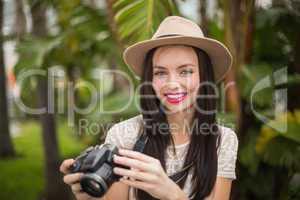 Pretty brunette holding her camera