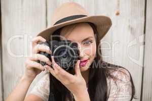 Pretty brunette taking a photo