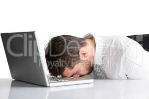 Exhausted businessman sleeping head on laptop