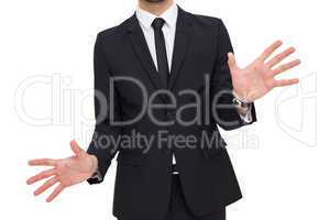 Businessman standing with hands spread out