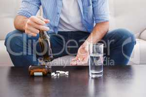 Close up of man showing pills and holding bottle