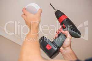 Handyman installing smoke detector
